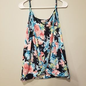 Floral tank top with twisted front bottom